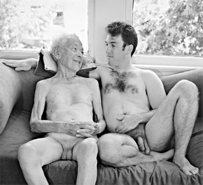 grandfather and grandson nude, sittinjg next to each other on a couch