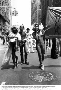 Marsha P. Johnson, Sylvia Rivera and other Stonewall heroes marching in 1979.
