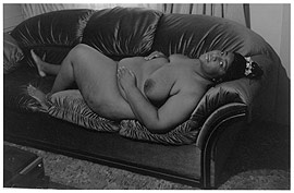 fat African American woman lying on a couch