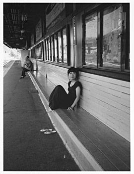 Okuda in train station